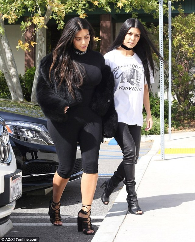 Stylish: Kourtney wore tight leather leggings and boots