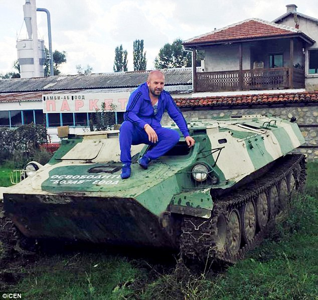 Bounty hunter: Bulgarian gangster Dinko Valev stis on an armoured vehicle which he uses to track down and round up illegal migrants near his home in the city of Yambol in south-eastern Bulgaria