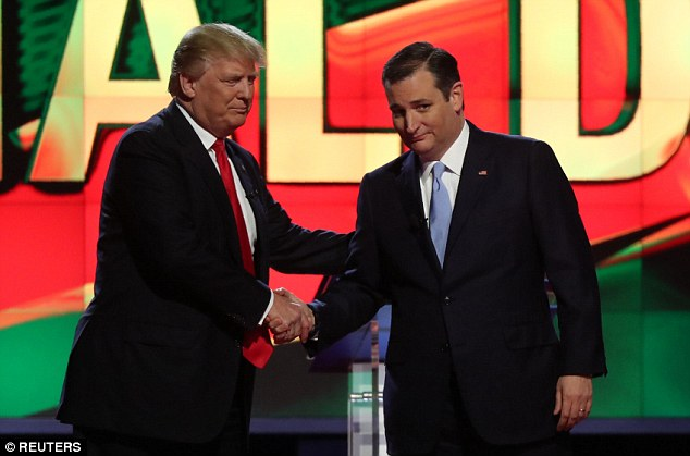 Trump (left) shakes hands with rival Ted Cruz as they arrive onstage at the CNN at the University of Miami