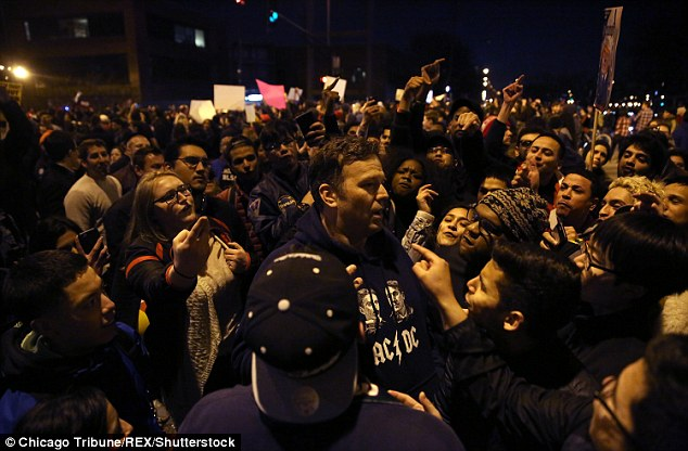 On the street: Trump supporters and protesters clash outside the UIC Pavilion after the cancelled rally for the Republican presidential candidate in Chicago