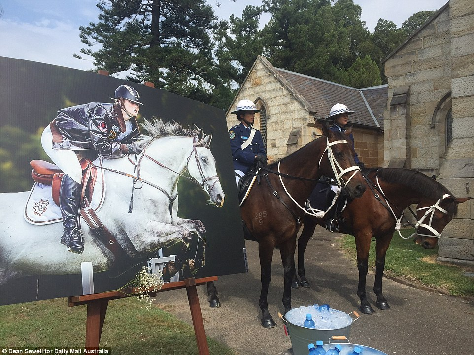 Two officers on horseback were outside the church during the service, and later escorted the hearse