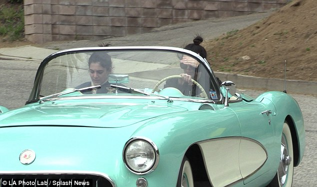 Vroom! Kendall Jenner went for a spin in a mint-green 1957 Corvette Stingraythrough Beverly Hills with her lookalike gal pal Lauren Perez on Sunday