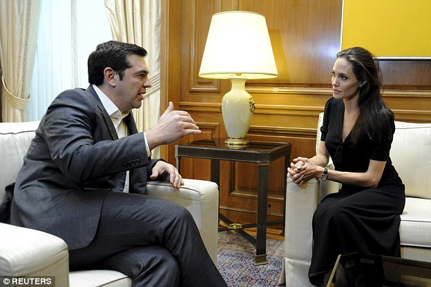 Greek Prime Minister Alexis Tsipras (left) meets UNHCR Special Envoy Angelina Jolie (right) at the Maximos Mansion in Athens