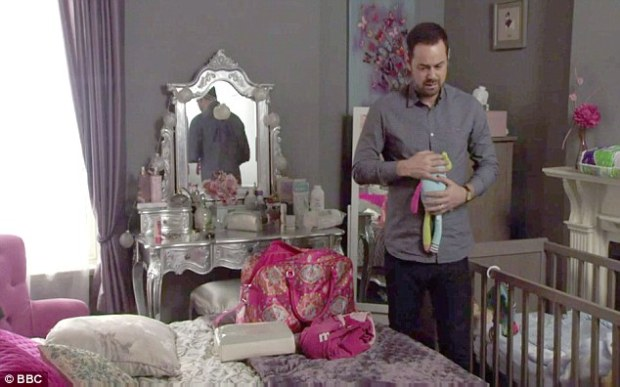 Emotional scenes: The moment came as his on-screen alter ego, Mick Carter, discussed the ill health of his child while holding a teddy bear from its cot