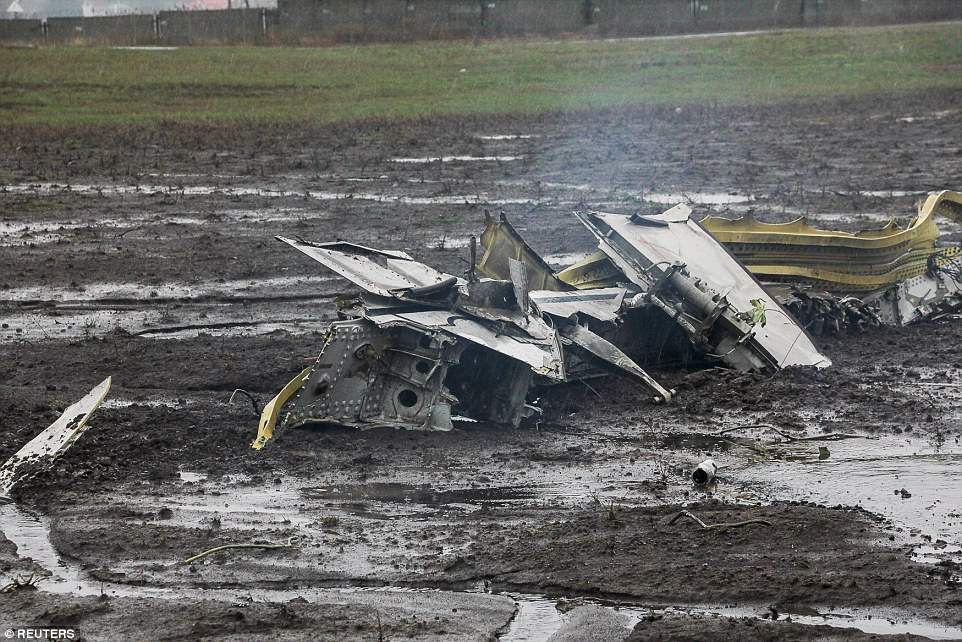 The plane appears to have disintegrated after hitting the ground, with a piece of thefuselage scattered across the crash site