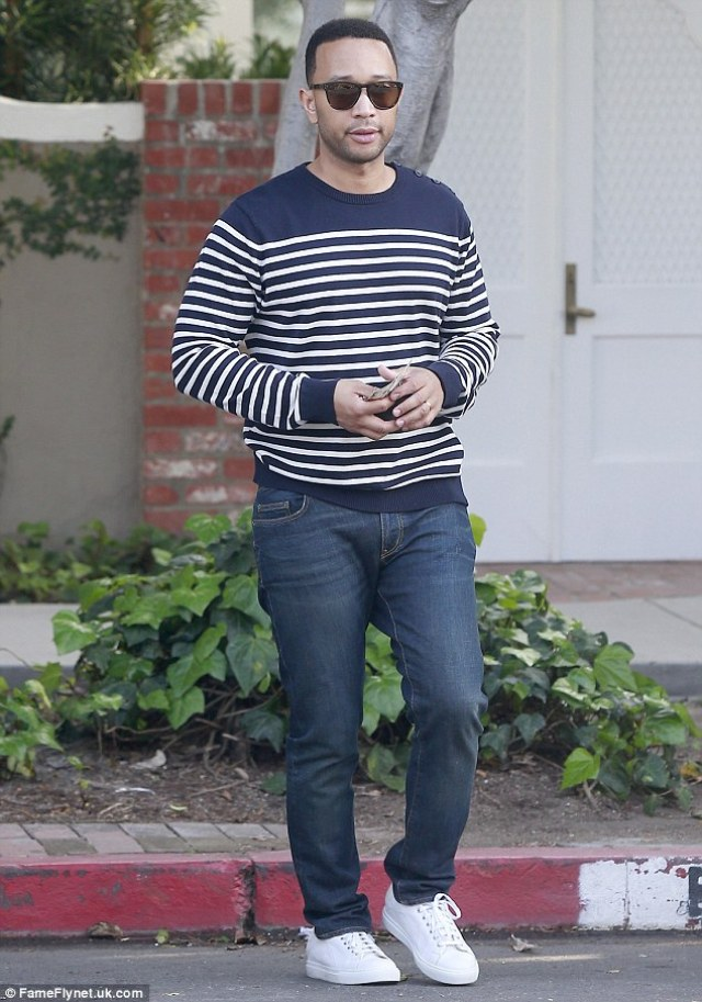 Street chic: Chrissy's husband, John Legend, 37, wore a navy and white striped sweater, and dark denim jeans