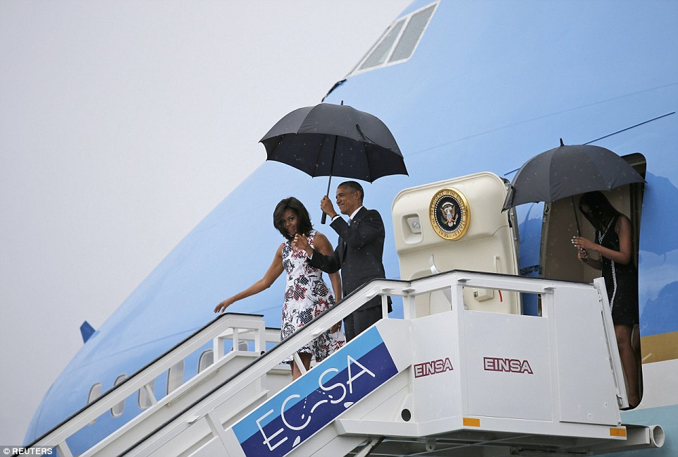 Air Force One touched down in Havana - just as the heavens let down a pouring rain - arriving at 4:20pm ET on Sunday for a visit the White House says will 'deepen' America's relationship with the government following more than half a century of tension
