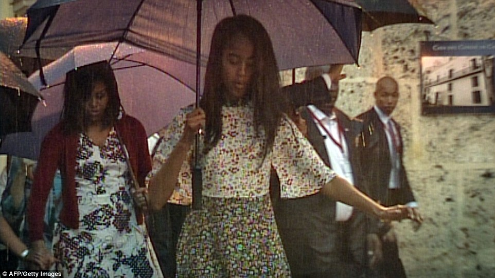 Michelle and Malia Obama were also careful to stay on their feet as they made their way through the old town's center