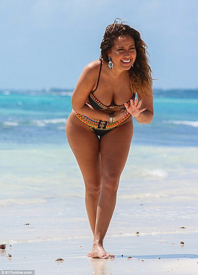 Larking around:The 32-year-old actress and singer, who found fame in pop group 3LW, showed off her incredible curves in a boldly coloured, barely-there bikini which struggled to contain her ample assets