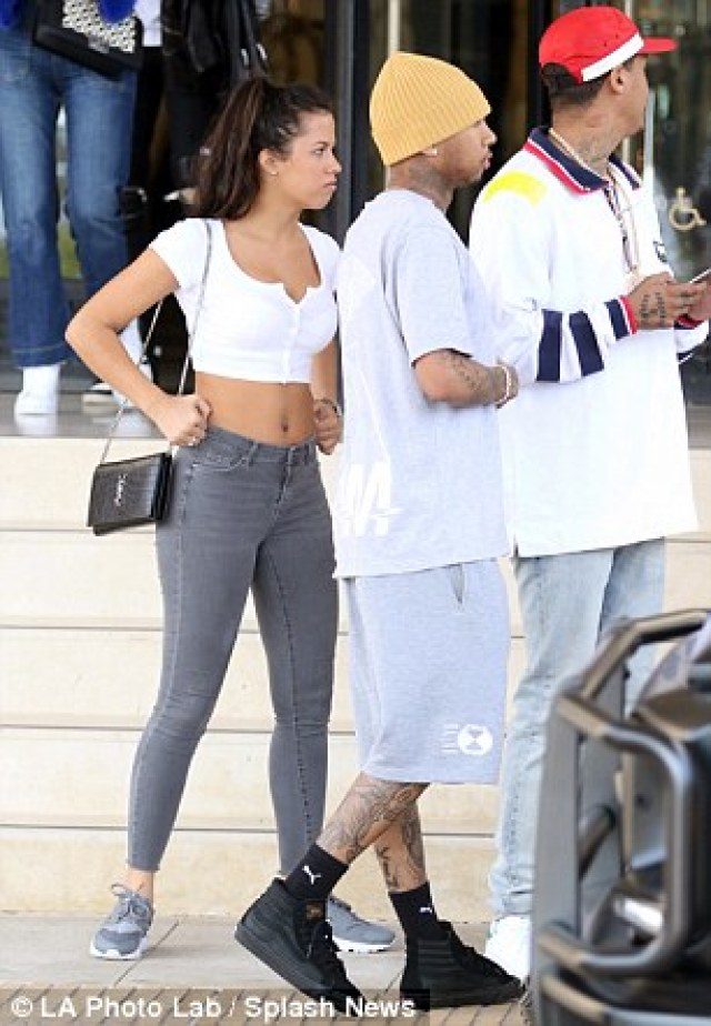 Relaxing day: Tyga, who is in a relationship with Kylie Jenner, 18, added a mustard hued knitted beanie, black socks and matching sneakers while out with his friends