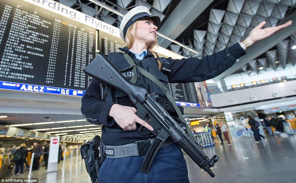 An armed policewoman on patrol in Frankfurt Airport in Germany  as security measures were ramped up at transport hubs around the world