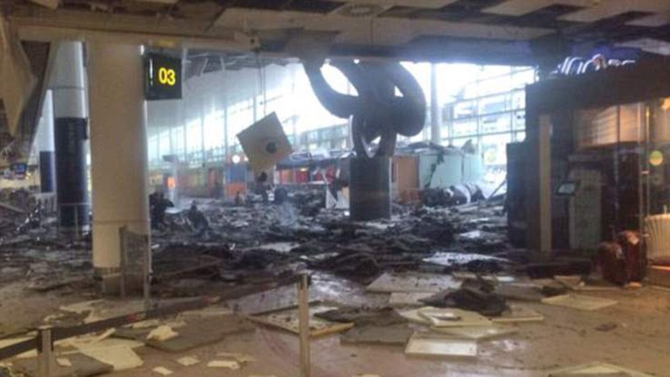 Obliterated: Ceiling tiles and debris are littered across the floor of the terminal building after twins blast rocked the check-in area