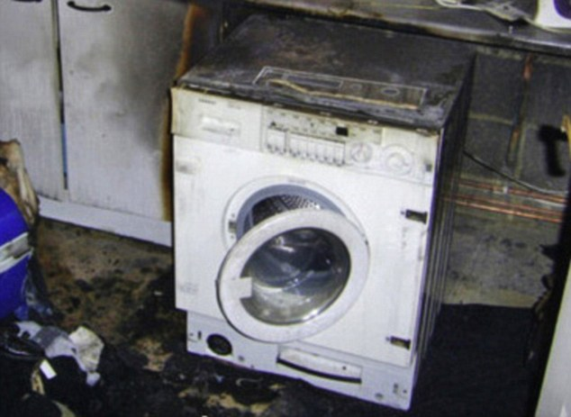 Disaster: A burnt-out washing machine in Cheshunt, Herts. The Chief Fire Officers Association says it was never consulted on plans to offer all families cheaper energy during the night