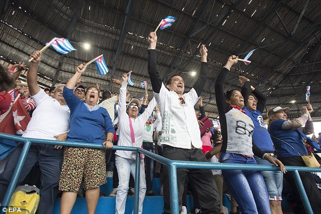 FANS: Awaiting Obama at the baseball game were 55,000 Cubans who had waited hours to see the American president in person
