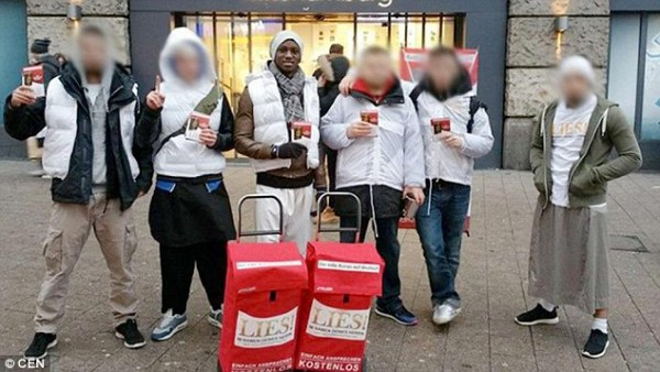 Here he is pictured with friends campaigning at the main train station in Hamburg, his adopted home