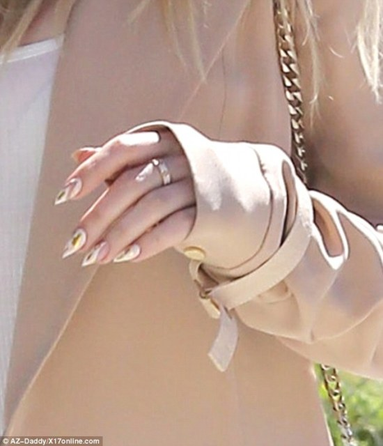 Looking sharp: The 31-year-old reality star showed off her claw-like manicure