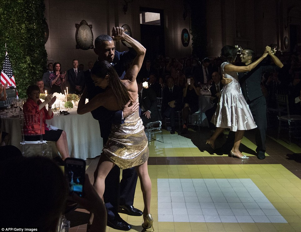 Guests applaud, cheer and film as Obama joins in a tango with a female dancer on Wednesday night during his visit to Argentina