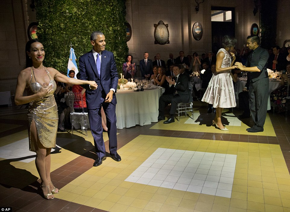 Despite criticism from fellow politicians after refusing to call off his trip following the Brussels terror attack, Obama showed he plans to carry on regardless on Wednesday night while dancing the tango