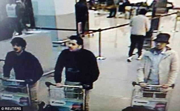 The second suicide bomber (left) who blew himself up at Brussels airport has been identified as master bombmaker Najim Laachraoui as police search for the mystery man in white. The bomber in the middle is believed to be Ibrahim al-Bakraoui