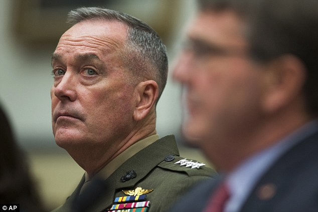 Joint Chiefs Chairman Gen. Joseph Dunford listens at left as Defence Secretary Ash Carter announced the death of the ISIS finance minister