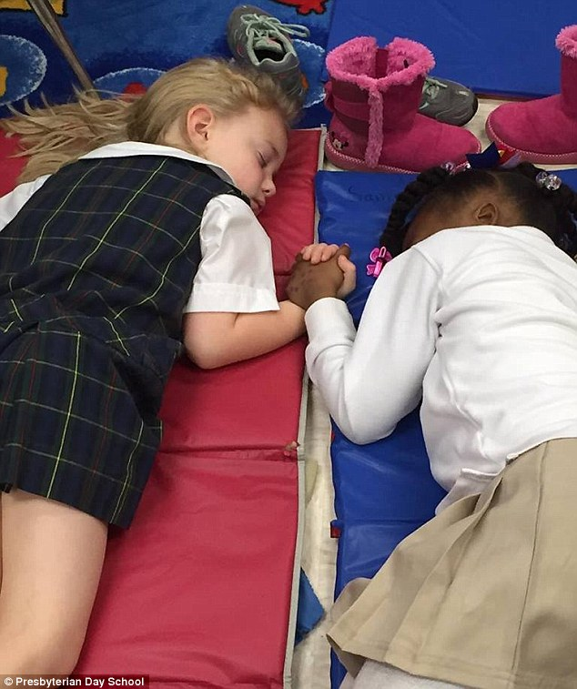 Friendship: This picture ofLucy Harris Jackson, left, and Samiyah Moore, right, has prompted outpouring of emotion online