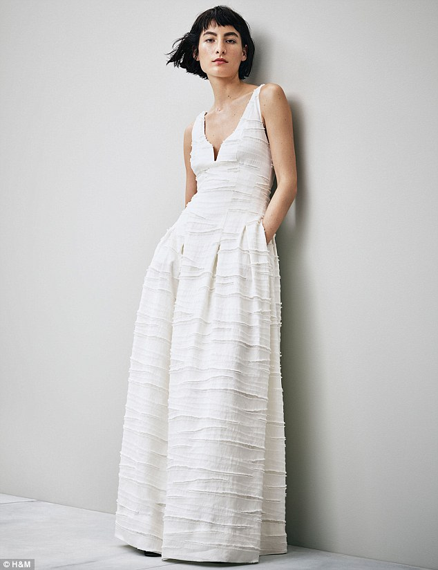 A growing trend for more affordable wedding dresses has seen high street brands ASOS and H&M both launch cut-price bridal collections in recent weeks. Pictured: This wedding dress from H&M costs just £149.99