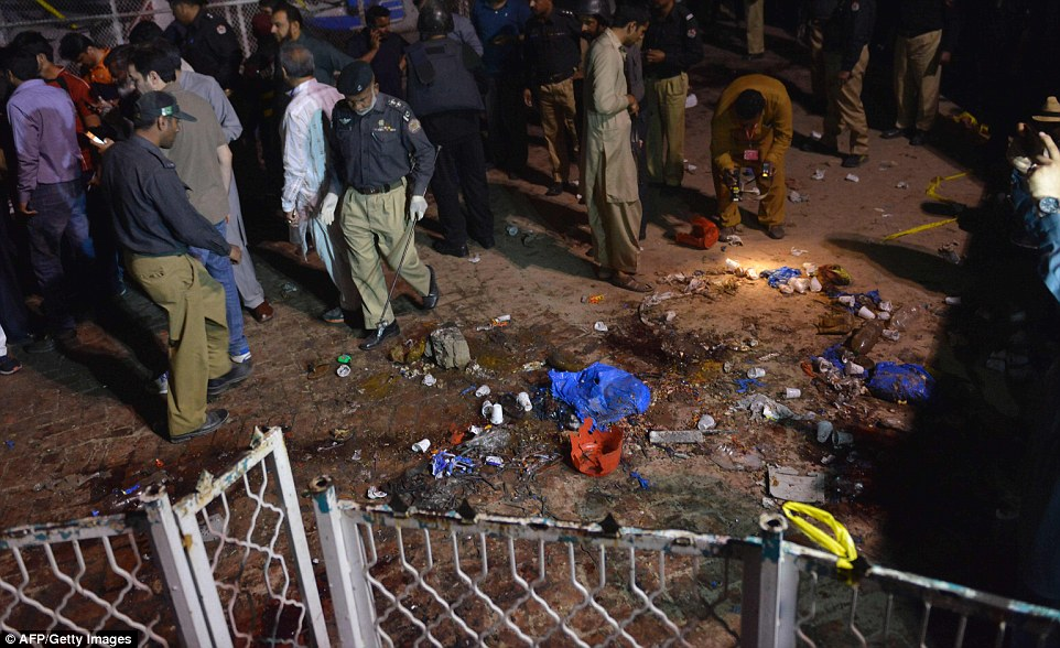 People were seen picking up the debris which was scattered on the ground after the bomb went off