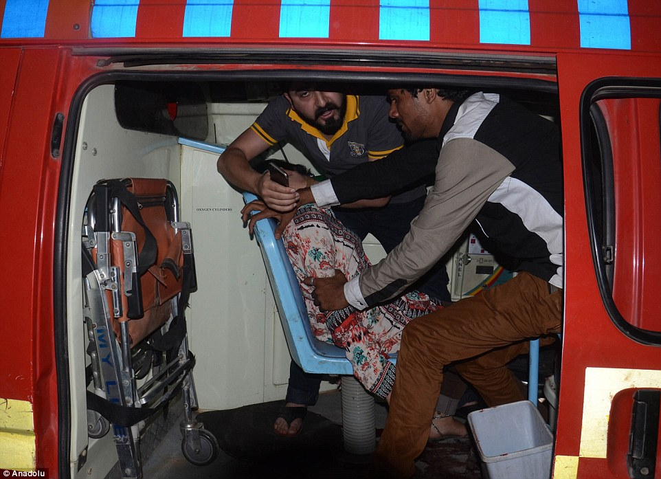 An injured woman is taken to a hospital after a suicide bomber blew himself up in a crowded park