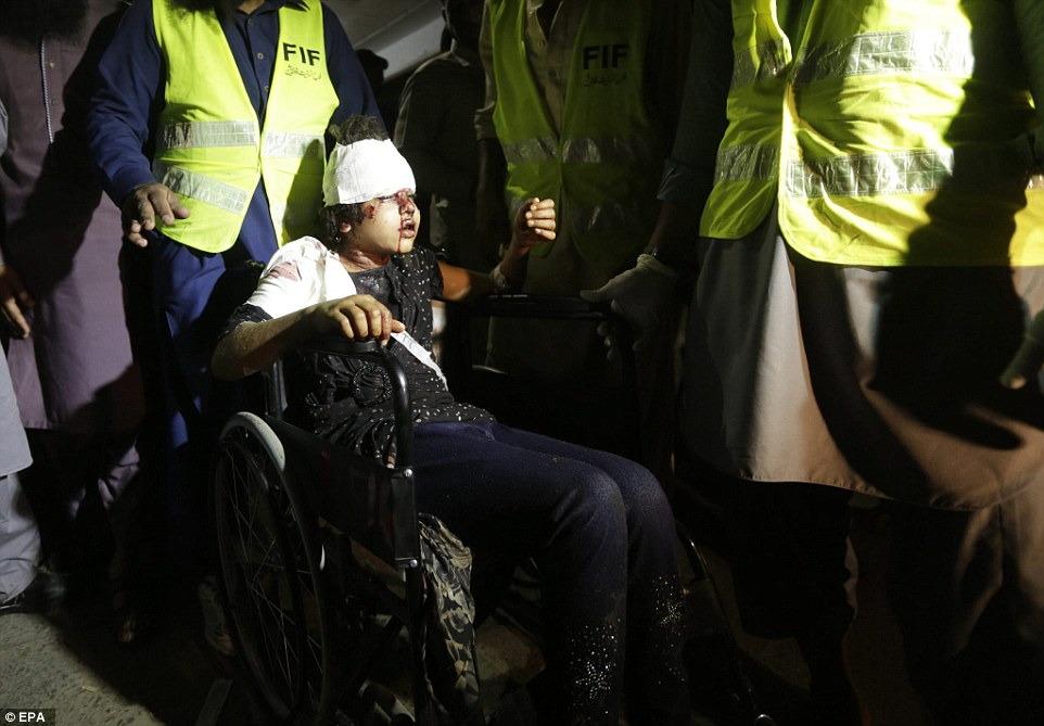 A girl who was injured in the suicide bomb blast is rushed to a hospital in Lahore in the wake of the bombing