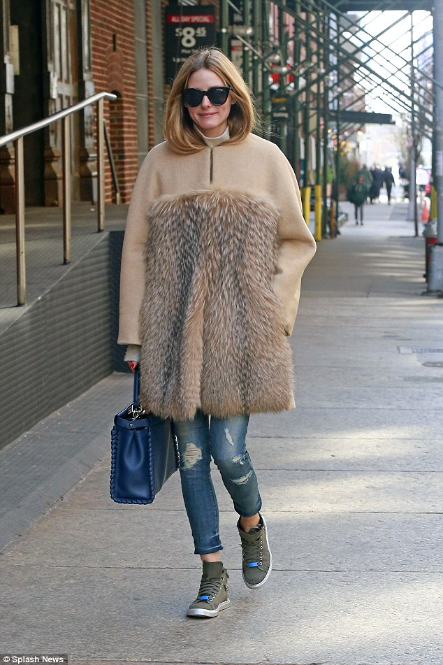 Furry nice: Olivia Palermo, 30, put on an eye-catching display as she stepped out in Tribeca, New York, in a lavish fur coat on Sunday