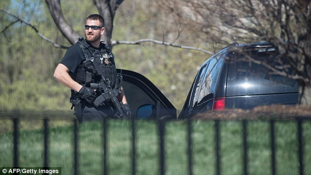 An officer stands guard as the US Capitol is secured after a visitor opened fire in the visitor center on Monday