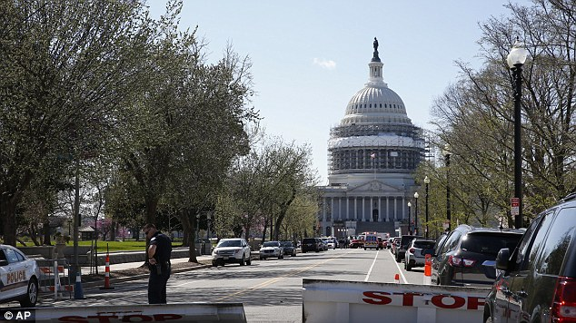 The government building (pictured after the shooting) is just meters away from the White House