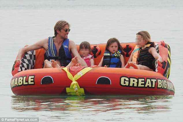 All aboard!In full holiday mode, Peter piled onto a huge inflatable with little Sophia, as they got prepped to take on the waters for a touch of water sports