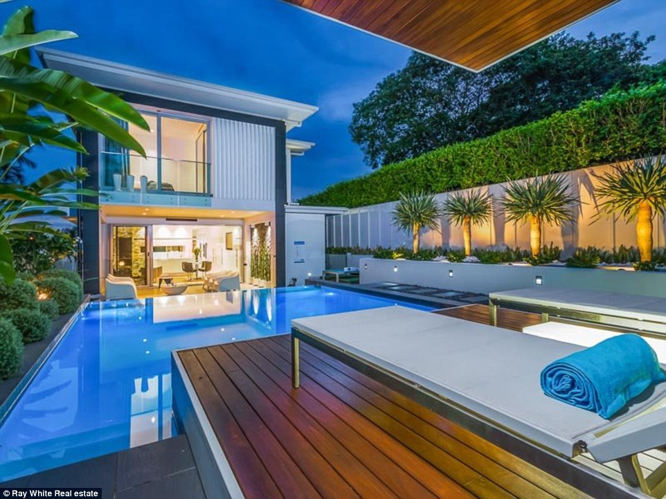 Brisbane homeowners spend over $30k to create waterfall ... on Uphill Backyard Ideas  id=21638