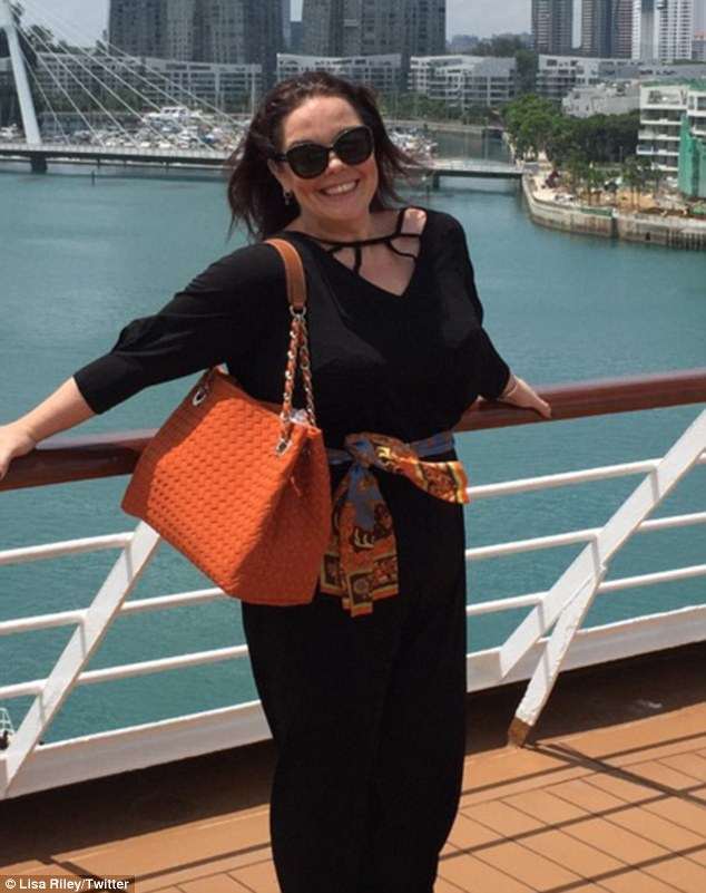 'Flying high on life!' Lisa Riley shows off her slimmer figure in a black ensemble while holidaying in Singapore recently in a candid Twitter photo