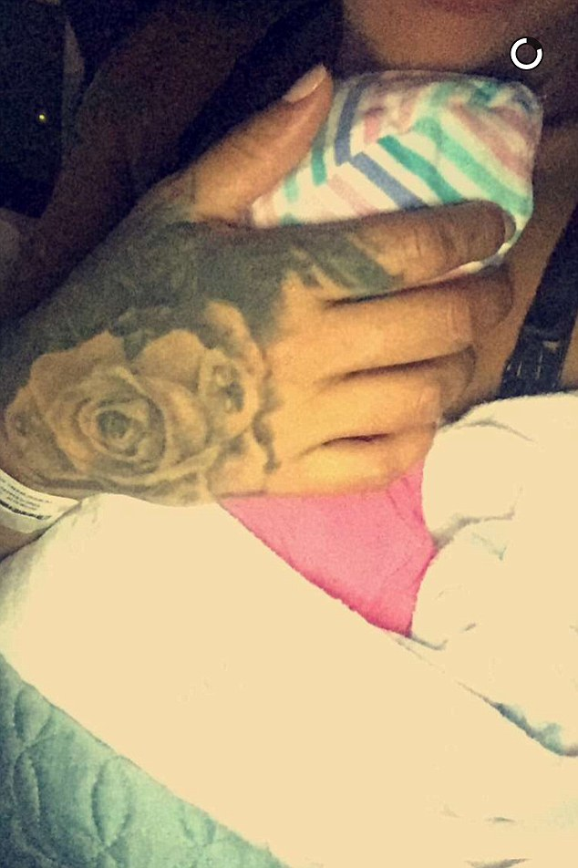 First selfie: She shared a picture of herself cradling the newborn on Snapchat