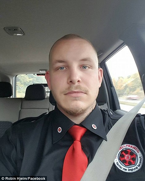 Denial: Mr Ljung has denied the group has neo-Nazi sympathies although admits that 'of course' some of its members have been involved in the movement. Here, member Robin Hjelm wears his Nationell Framtid uniform