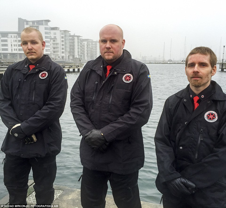 Patrol: Dennis Ljung, 31 (centre) and his colleagues voluntarily patrol  the strait of Öresund for illegal migrants in a speedboat