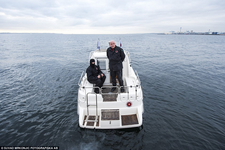 Charge: Three-men teams on two boats speed towards 'suspicious targets' and shout at them to turn around until they return to Denmark