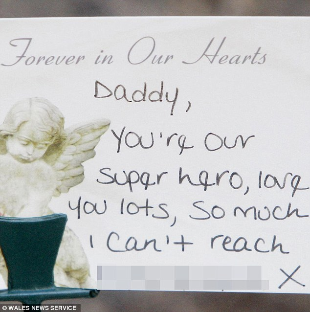A message from Tommy Brown's wife and son adorns tributes laid out in his honour at his funeral