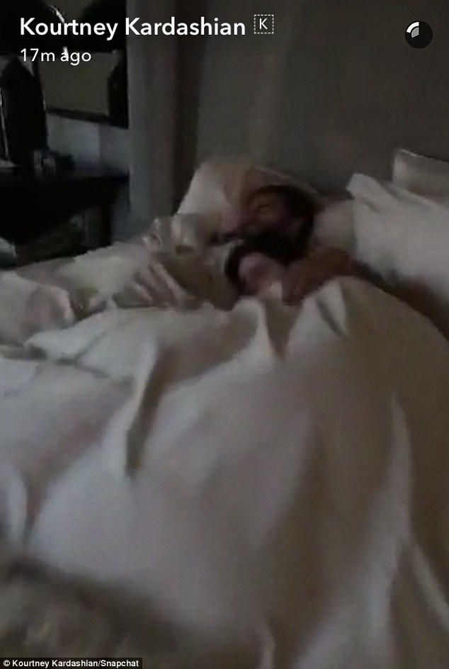 Sleeping beauties:Flinging open the bedroom door, Kourtney finds Scott and Kendall in a sweet caress under the down comforter