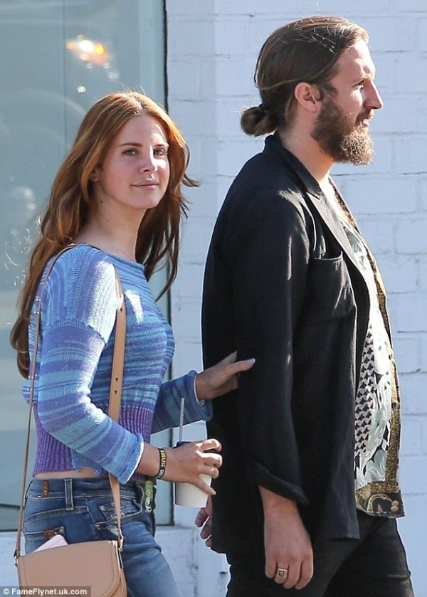 Lana Del Rey cosies up to a bearded mystery man as they ...