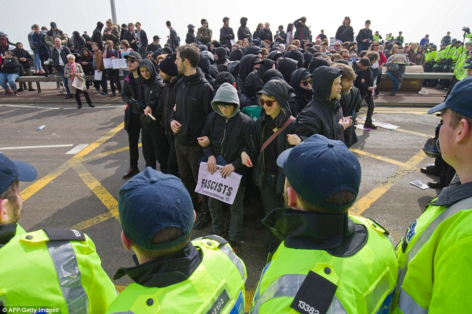 Police surround anti-racism demonstrators as they block the route of a planned far right march through Dover