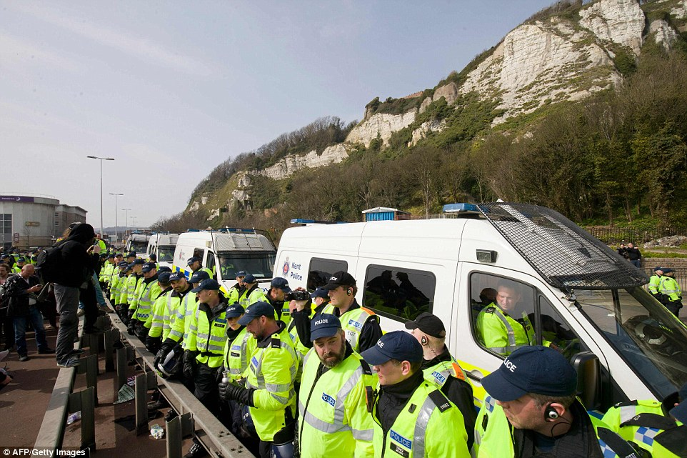 Police officers stand in a line as anti-racism demonstrators block the route of a planned far right march in Dover