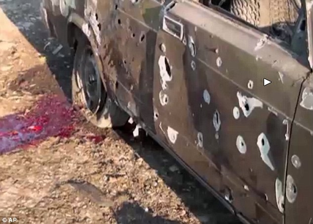A car lays destroyed with blood showing in the aftermath of heavy fighting in Terter, Azerbaijan, between Armenian and Azerbaijani forces over the separatist region of Nagorno-Karabakh