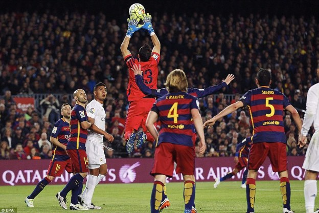 Barca keeper Claudio Bravo rises high to claim a corner as both sides chased a breakthrough goal