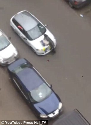 Video footage of the incident shows the car, which had ploughed through a police road block, driving head-on into the woman as she crossed the road