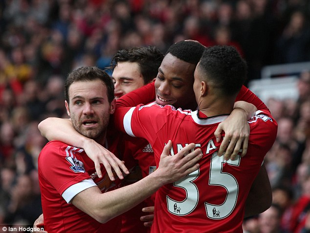 Manchester United team-mates embrace the Frenchman as they moved up to fifth in the Premier League