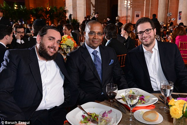 Jeremy Reichberg (left) and Jona Rechnitz (right) flanked former top NYPD officer Philip Banks at a charity dinner. The two businessmen are major donors to New York City mayor Bill de Blasio