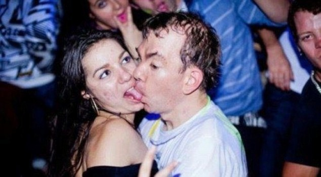 Another couple manage to pull off the most uncoordinated kiss of all time, complete with tongue-sucking and a glow stick necklace